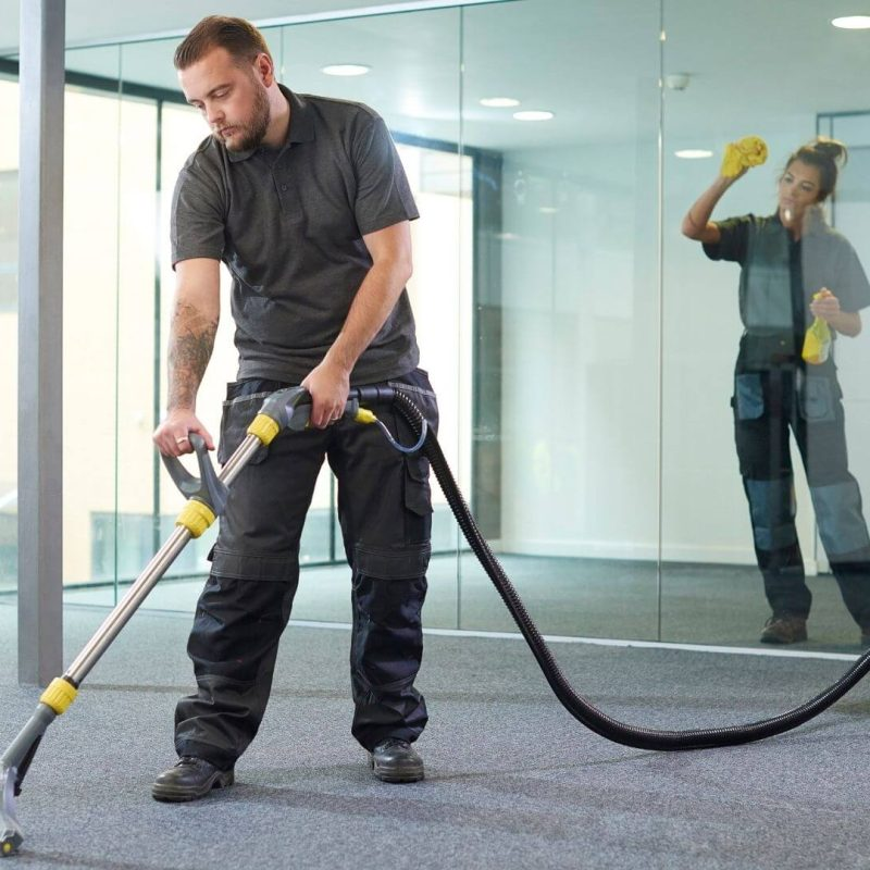 two cleaner in a uniform cleaning an office